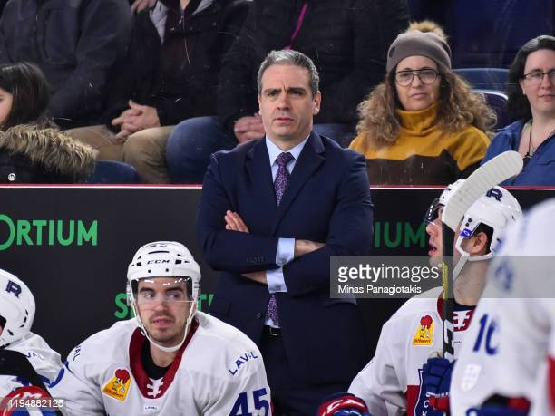 Head coach of the Laval Rocket Joel Bouchard looks on from the bench against the Rockford IceHogs during the second period at Place Bell on December...