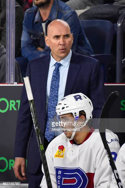 Head coach of the Laval Rocket Sylvain Lefebvre looks on from behind the bench against the Binghamton Devils during the AHL game at Place Bell on...