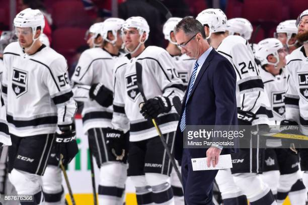 Head coach of the Los Angeles Kings John Stevens walks past his team celebrating against the Montreal Canadiens during the NHL game at the Bell...