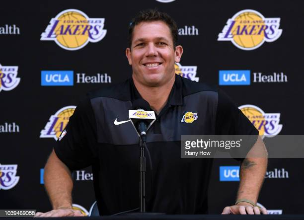 Head coach of the Los Angeles Lakers Luke Walton laughs with the press during the Los Angeles Lakers Media Day at the UCLA Health Training Center on...