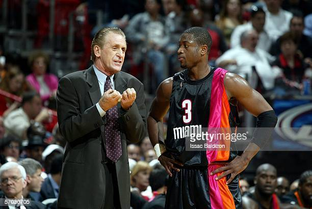 Head Coach of the Miami Heat Pat Riley coaches Dwyane Wade of the Miami Heat on March 8, 2006 at American Airlines Arena in Miami, Florida. NOTE TO...