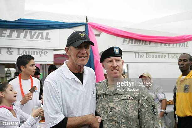 Head Coach of the Miami Heat Pat Riley takes photos with fans during the 2007 Family Festival on April 15 2007 at Watson Island in Miami Florida NOTE...