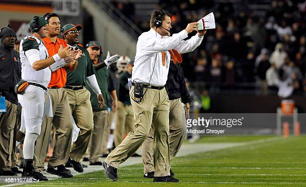Head coach of the Miami Hurricanes Al Golden calls a time out in the first half against the Virginia Tech Hokies at Lane Stadium on October 23, 2014...