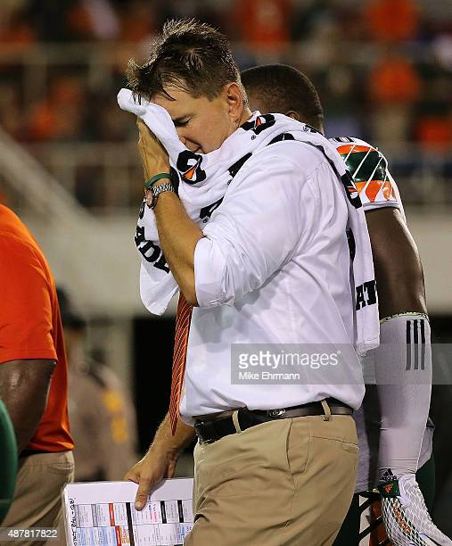 Head coach of the Miami Hurricanes Al Golden walks off the field after a weather warning during the a game against the Florida Atlantic Owls at FAU...