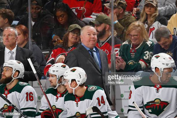 Head Coach of the Minnesota Wild Bruce Boudreau looks on from behind the bench during the game against the New Jersey Devils at the Prudential Center...