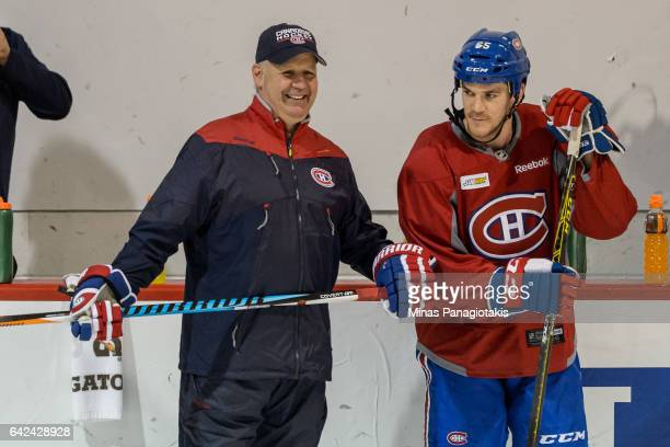 Head coach of the Montreal Canadiens Claude Julien has a laugh with Andrew Shaw during the Montreal Canadiens practice session at the Bell Sports...