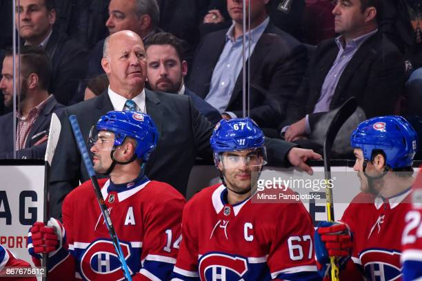 Head coach of the Montreal Canadiens Claude Julien looks on from the bench against the Los Angeles Kings during the NHL game at the Bell Centre on...