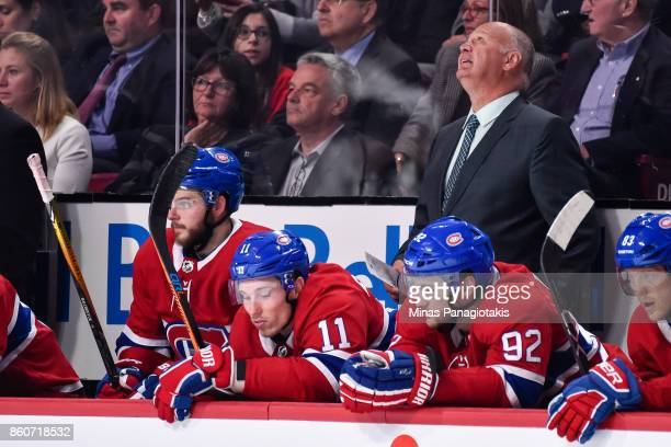 Head coach of the Montreal Canadiens Claude Julien looks up at the scoreboard against the Chicago Blackhawks during the NHL game at the Bell Centre...