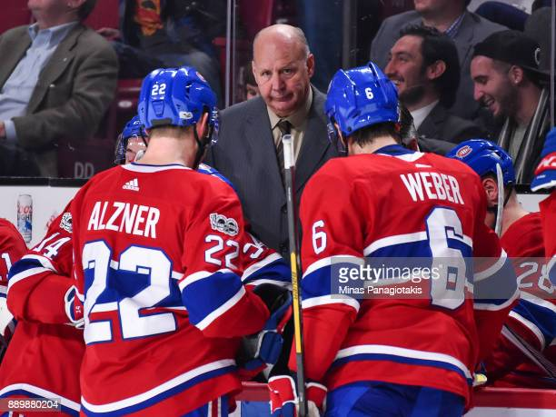 Head coach of the Montreal Canadiens Claude Julien regroups his players against the Calgary Flames during the NHL game at the Bell Centre on December...