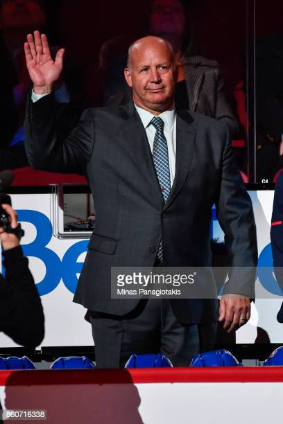 Head coach of the Montreal Canadiens Claude Julien salutes the fans during the pre game ceremony prior to the NHL game against the Chicago Blackhawks...
