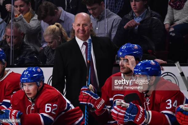 Head coach of the Montreal Canadiens Claude Julien smiles behind the bench during the NHL game against the Winnipeg Jets at the Bell Centre on...