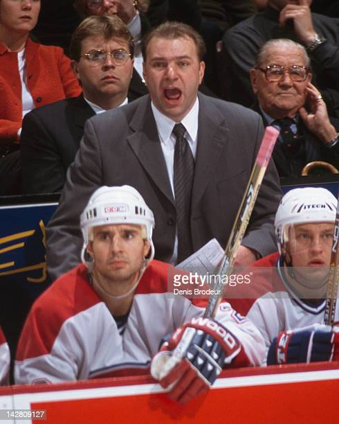 Head Coach of the Montreal Canadiens Michel Therrien reacts to a play on the ice during a game at the Molson Centre circa 2001 in Montreal Quebec...