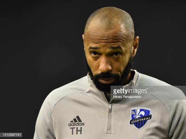 Head coach of the Montreal Impact Thierry Henry looks on in the warmup against CD Olimpia during the 1st leg of the CONCACAF Champions League...