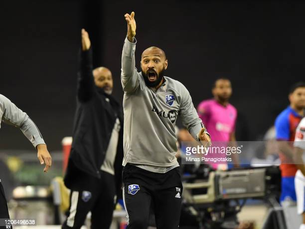 Head coach of the Montreal Impact Thierry Henry reacts after a decision was taken to reverse a penalty shot awarded to the Montreal Impact against CD...