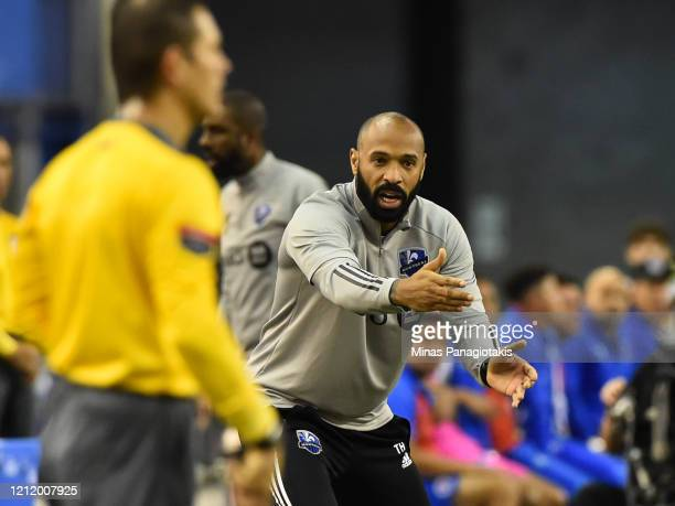 Head coach of the Montreal Impact Thierry Henry reacts against CD Olimpia in the second half during the 1st leg of the CONCACAF Champions League...