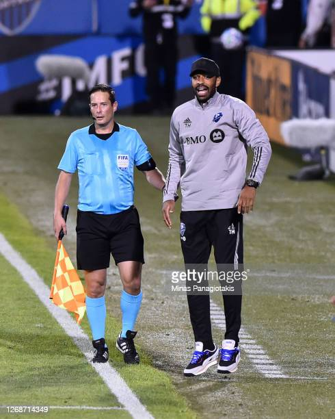 Head coach of the Montreal Impact Thierry Henry reacts during the first half of the MLS game against the Vancouver Whitecaps at Saputo Stadium on...