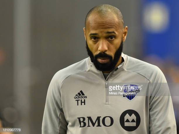 Head coach of the Montreal Impact Thierry Henry takes to the pitch prior to the game between the Montreal Impact and CD Olimpia during the 1st leg of...
