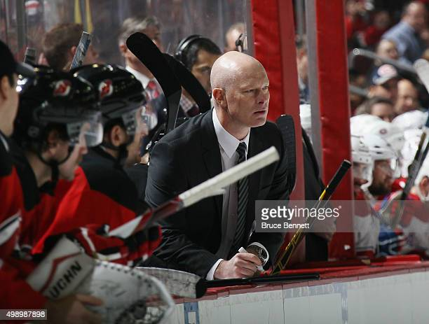 Head coach of the New Jersey Devils John Hynes handles ench duties against the Montreal Canadiens at the Prudential Center on November 27 2015 in...