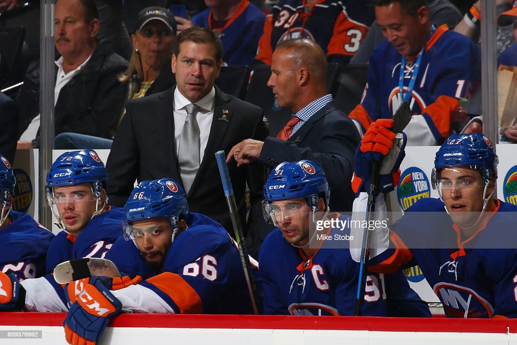 Head coach of the New York Islanders Doug Weight and Associate Coach Grag Cornin looks on from the bench during the game against the Buffalo Sabres at Barclays Center on October 7, 2017 in New York City.