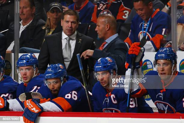 Head coach of the New York Islanders Doug Weight and Associate Coach Grag Cornin looks on from the bench during the game against the Buffalo Sabres...