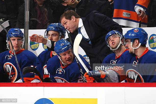 Head coach of the New York Islanders Doug Weight speaks to Anders Lee during a game against the Los Angeles Kings at the Barclays Center on January...