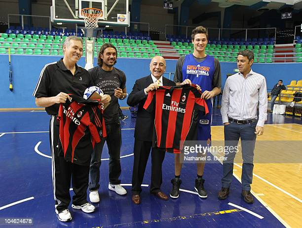 Head Coach of the New York Knicks Mike D'Antoni and player Danilo Gallinari receive AC Milan jerseys from MikePaolo Maldini Adriano Galliani and...