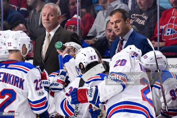 Head coach of the New York Rangers Alain Vigneault gathers his players in the third period against the Montreal Canadiens during the NHL game at the...