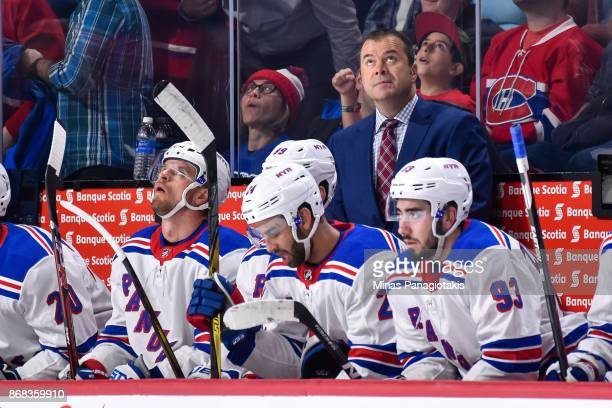 Head coach of the New York Rangers Alain Vigneault looks on from behind the bench against the Montreal Canadiens during the NHL game at the Bell...