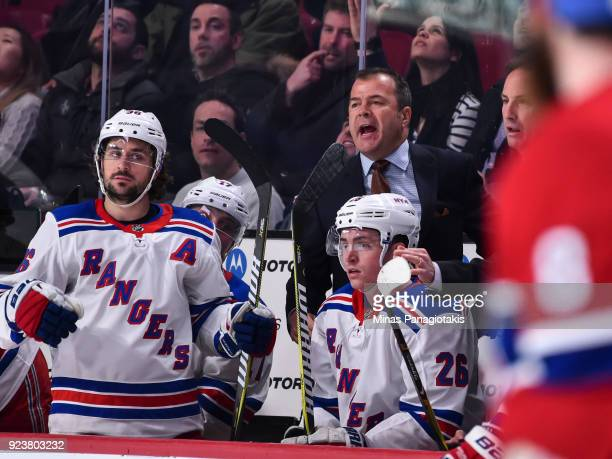 Head coach of the New York Rangers Alain Vigneault yells out from behind the bench against the Montreal Canadiens during the NHL game at the Bell...