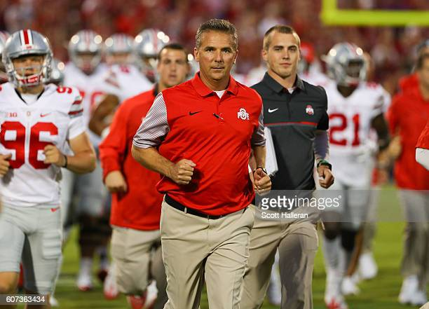 Head coach of the Ohio State Buckeyes Urban Meyer leads the team onto the field prior to the game between Ohio State and Oklahoma at Gaylord Family...
