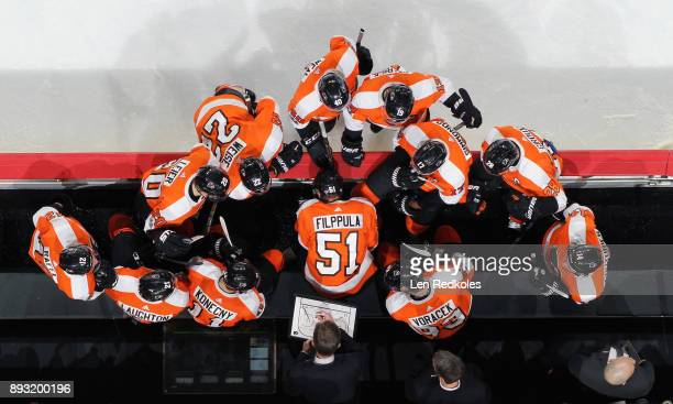 Head Coach of the Philadelphia Flyers Dave Hakstol draws up a play for his team during a stoppage in play against the Buffalo Sabres on December 14...