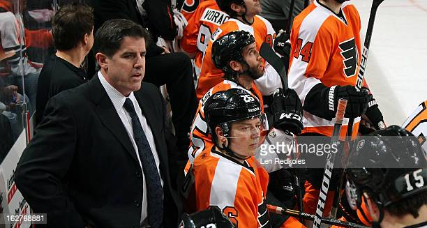 Head Coach of the Philadelphia Flyers Peter Laviolette watches the play with his team against the Florida Panthers on February 21 2013 at the Wells...