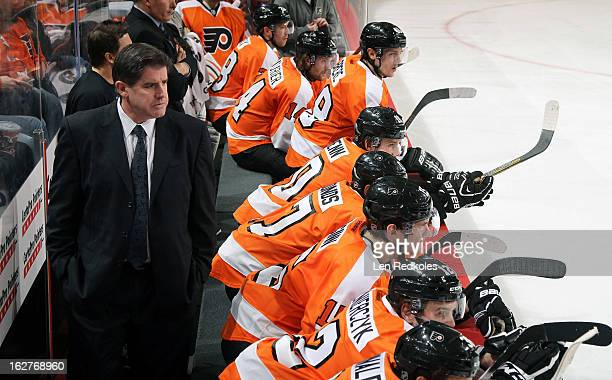 Head Coach of the Philadelphia Flyers Peter Laviolette watches the play with his team against the Florida Panthers on February 21, 2013 at the Wells...