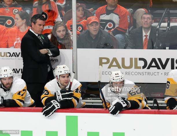 Head Coach of the Pittsburgh Penguins Mike Sullivan looks on during the first period behind Bryan Rust Conor Sheary and Carl Hagelin against the...