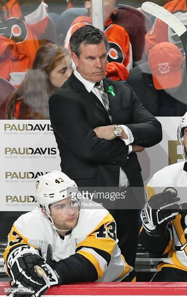 Head Coach of the Pittsburgh Penguins Mike Sullivan looks on during the first period behind Conor Sheary against the Philadelphia Flyers in Game Four...
