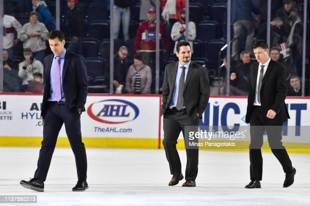 Head coach of the Providence Bruins Jay Leach assistant coaches Trent Whitfield and Ryan Mougenel walk across the ice after their loss to the Laval...