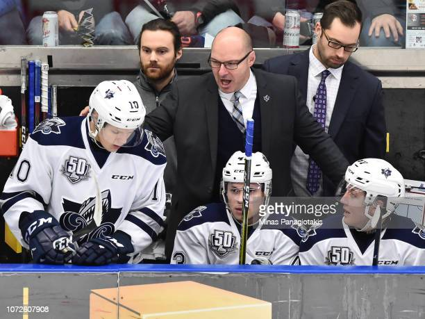 Head coach of the Rimouski Oceanic Serge Beausoleil encourages his players against the BlainvilleBoisbriand Armada during the QMJHL game at Centre...