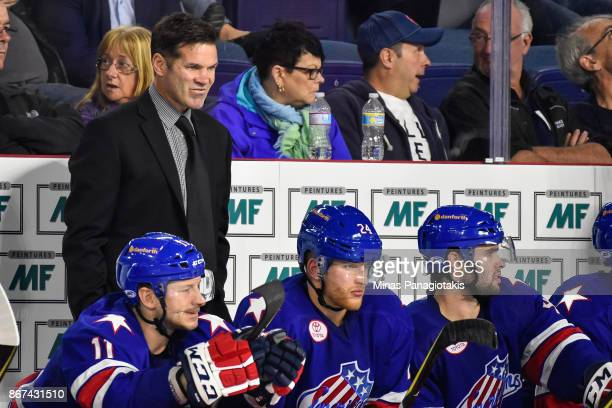 Head coach of the Rochester Americans Chris Taylor looks on against the Rochester Americans during the AHL game at Place Bell on October 25 2017 in...