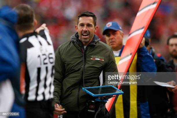 Head Coach of the San Francisco 49ers Kyle Shanahan talks to field judge Brad Rogers during the game against the Seattle Seahawks at Levi's Stadium...