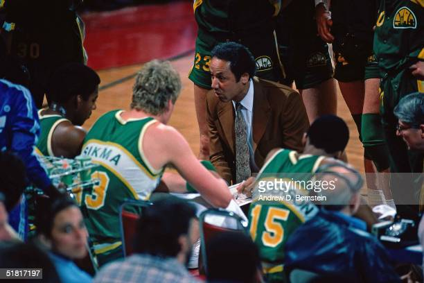 Head Coach of the Seattle Supersonics Lenny Wilkens talks to his players during an NBA game circa 1978 NOTE TO USER User expressly acknowledges and...