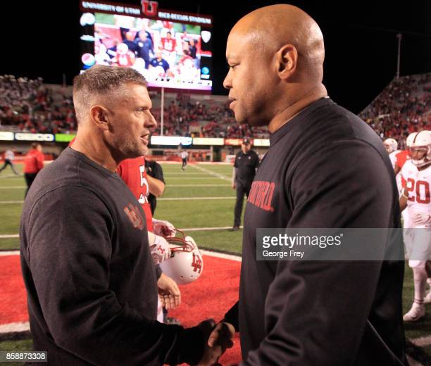 Head coach of the Stanford Cardinal David Shaw right and Utah Utes head coach Kyle Whittingham left shake hands after an college football game on...