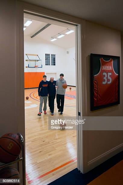 Head coach of the Syracuse men's basketball team Jim Boeheim is photographed with sons Jimmy and Jack for Sports Illustrated on December 12 2015 in...