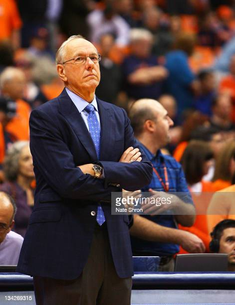 Head coach of the Syracuse Orange crosses his arms as he looks on from the sideline during the game against the Eastern Michigan Eagles at the...
