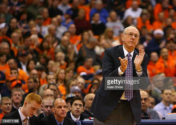 Head coach of the Syracuse Orange Jim Boeheim claps from the sideline during the game against the Florida Gators at the Carrier Dome on December 2...