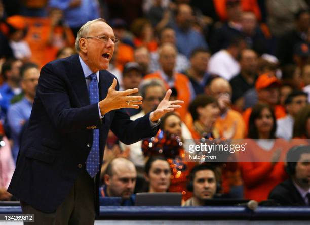 Head coach of the Syracuse Orange Jim Boeheim gestures as he yells to players on the court during the game against the Eastern Michigan Eagles at the...