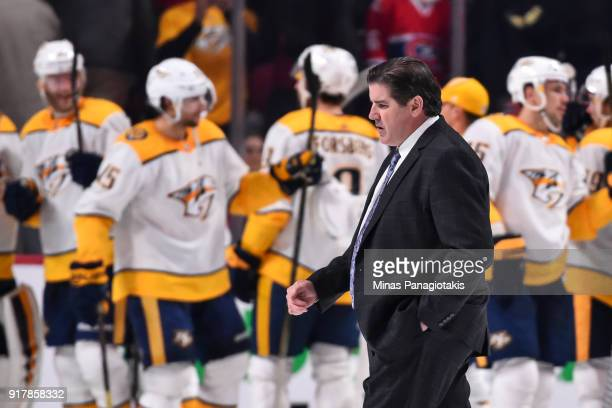 Head coach of the the Nashville Predators Peter Laviolette walks past his team as they celebrate their victory against the Montreal Canadiens during...