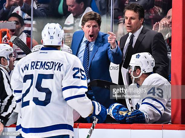 Head coach of the Toronto Maple Leafs Mike Babcock gives instructions to his players during a timeout at the NHL game against the Montreal Canadiens...
