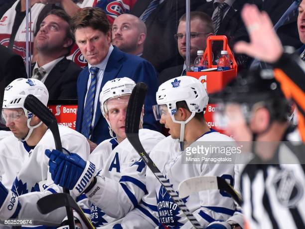 Head coach of the Toronto Maple Leafs Mike Babcock watches his players against the Montreal Canadiens during the NHL game at the Bell Centre on...