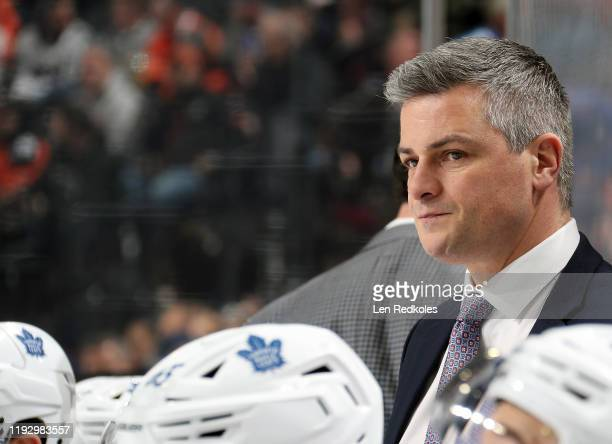 Head Coach of the Toronto Maple Leafs Sheldon Keefe watches a play develop on the ice against the Philadelphia Flyers on December 3, 2019 at the...