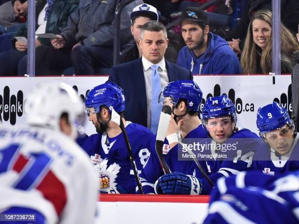 Head coach of the Toronto Marlies Sheldon Keefe looks on from behind the bench against the Laval Rocket during the AHL game at Place Bell on December...